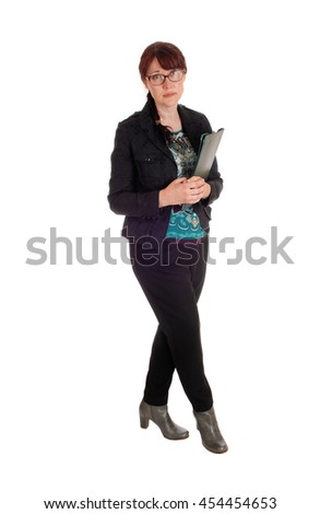 A Caucasian business woman standing with her clipboard in her hand, 