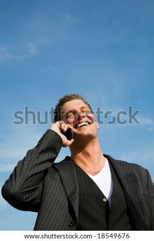 A caucasian businessman talking on the phone outdoor - stock photo