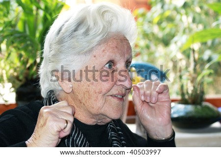 a caucasian elderly person with a great expression on her face - stock photo