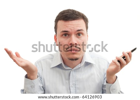 A caucasian male puzzled by phone call & technology - stock photo