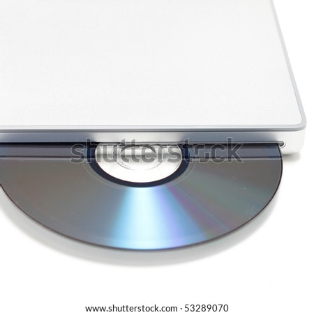 A CD in a laptop - stock photo