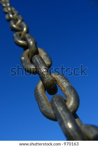A chain with the blue sky in the background - stock photo