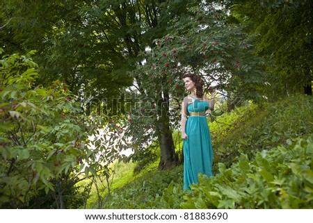 a charming woman in a blue dress - stock photo
