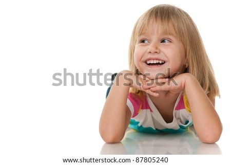 A cheerful little girl is looking away; isolated on the white background - stock photo