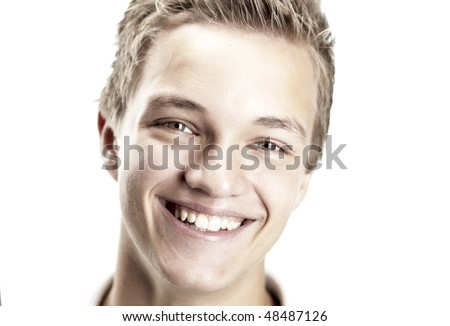 A Cheerful 16 year old boy on a white background - stock photo