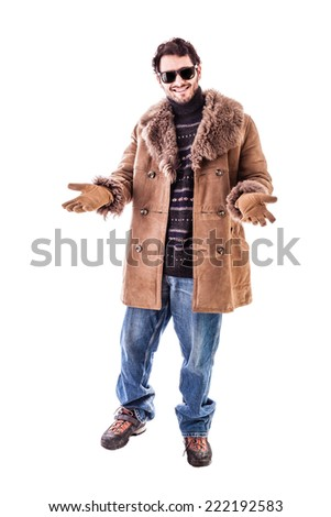 a cheerful young man wearing an expensive sheepskin furry coat isolated over a white background - stock photo