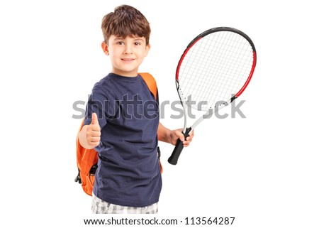 A child holding a tennis racket and giving thumb up isolated on white background - stock photo