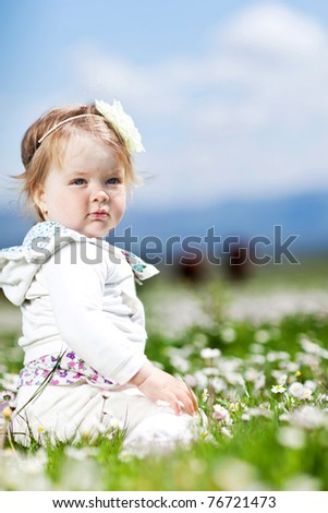 A child in a field of flowers - stock photo