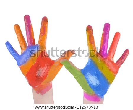 A child is holding up painted art hands on a white isolated background. There are vibrant rainbow colors. Use it for a creativity concept. - stock photo