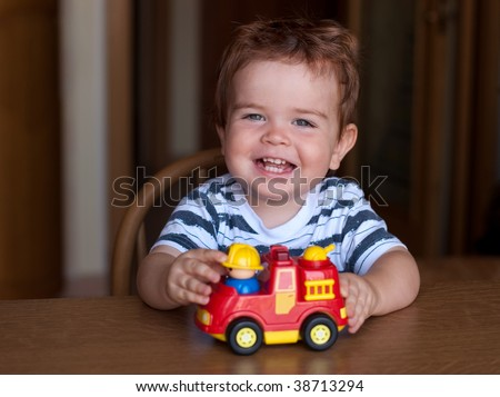 """a child playing with a """"fire"""" car - stock photo"""