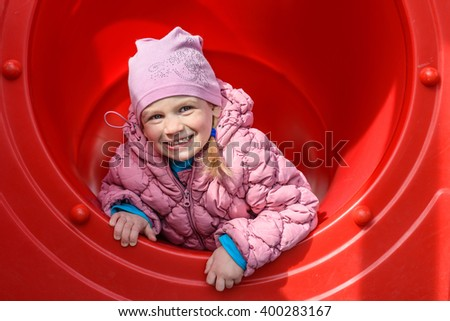 A child plays on the playground. Mobility and emotions. - stock photo