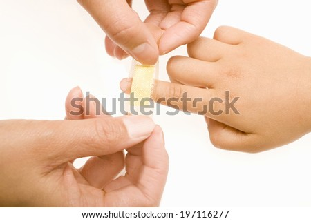 A Child'S Hand On Which A Band Aid Is Put - stock photo