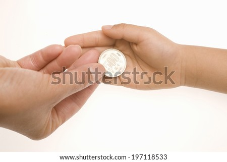 A Child'S Hands Receiving Pocket Money - stock photo
