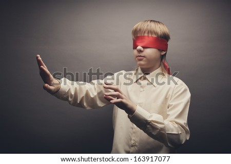 A child wearing a mask for the eyes - stock photo