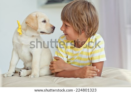 A child with a pet - stock photo