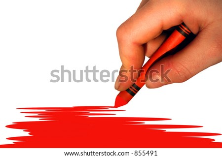 a childs hand and crayon - stock photo