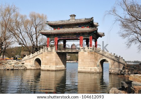 A Chinese bridge over the Summer Palace lake  in Beijing, China. - stock photo
