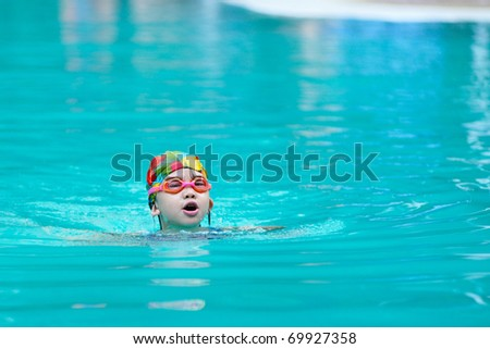 A Chinese little kid in the swimming pool - stock photo