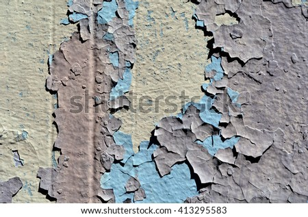 a chipped and peeling paint wall texture - stock photo