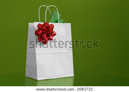 A christmas bag in green background - stock photo