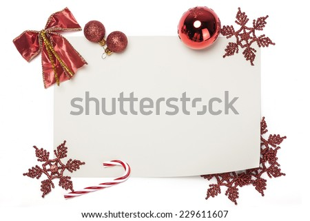 A christmas letter with ornaments for gift isolated white, top view at the studio. - stock photo