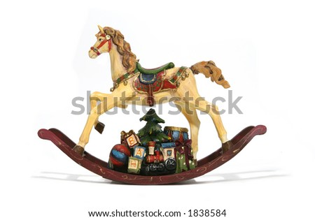 A Christmas rocking horse with presents underneath - stock photo