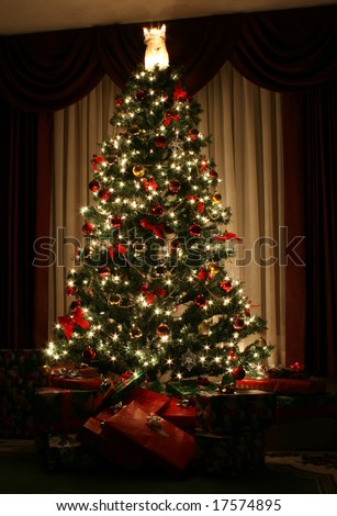 A Christmas tree lit up for the holidays. - stock photo