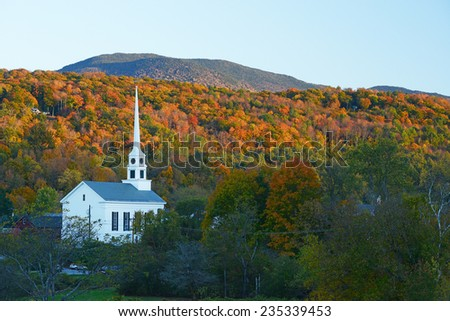 a church in autumn at stowe, vermont - stock photo