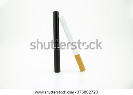 A cigarette leaning against an e-cigarette - stock photo