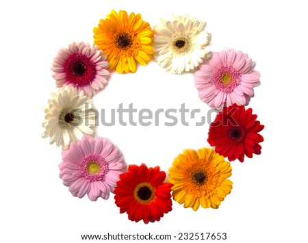 A circle of colorful flowers isolated over white - stock photo