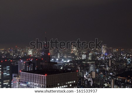 A city skyline during the night. - stock photo