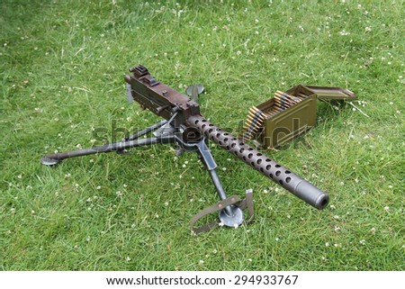 A Classic Military Machine Gun with Ammunition. - stock photo