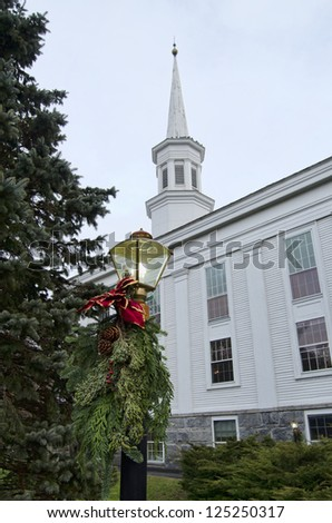 A classic New England church decorated for the holidays - stock photo
