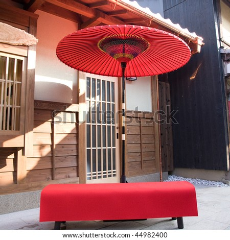 a classic travel background,japanese traditional umbrella in the streets of downtown kyoto japan - stock photo