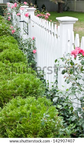 A classic white picket fence - stock photo