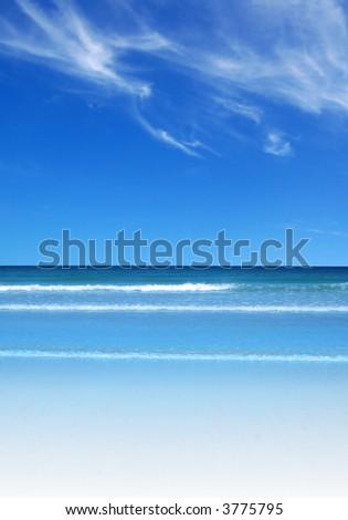 A clear beach and blue sky - stock photo
