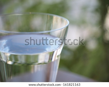 A clear plastic glass of water. - stock photo