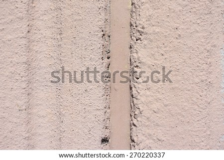 A clear view of an exterior grooved beige wall with expansion joint. - stock photo