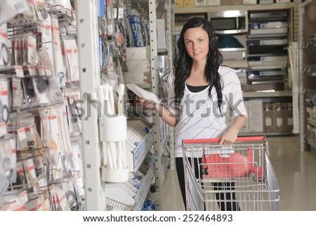 A client portrait in home appliance shop supermarket store - stock photo