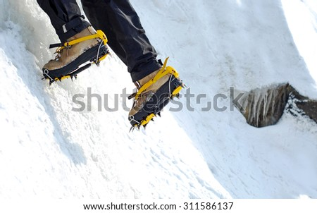 A climber reaching the summit - stock photo