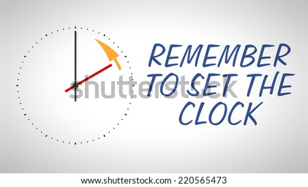 A clock at the wall with text remember to set the clock - stock photo