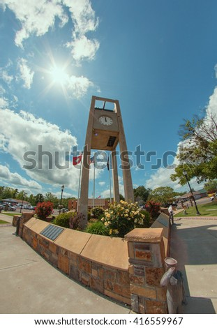 A clock town in a small town in rural Arkansas, USA. - stock photo