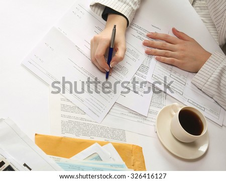 A close-up image of a hand with a pen showing a diagram - stock photo