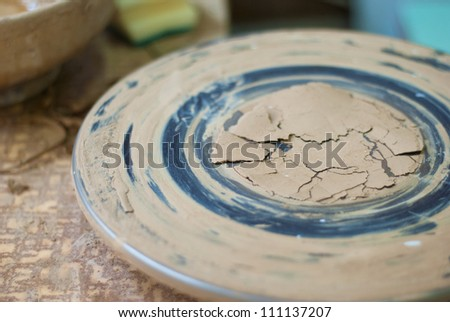 A close-up image of a pottery wheel with clay leftovers and shallow depth of field - stock photo