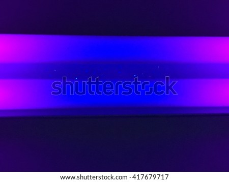 A close up look at two black light tubes.  - stock photo