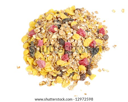 A close up macro of delicious healthy muesli with dry bits of pawpaw, pineapple, prunes and raisins - stock photo