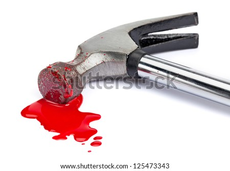A close-up of a bloody hammer and small blood pool (red paint) isolated on white. - stock photo
