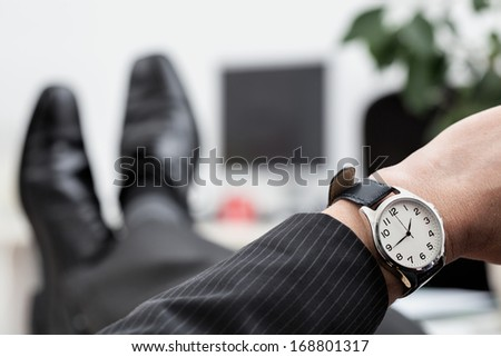 A close up of a businessman's elegant watch - stock photo