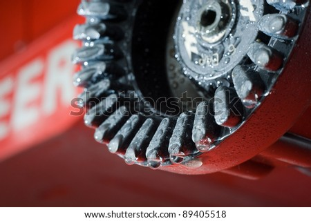 A close up of a fire nozzle in a fire station used by firefighters - stock photo