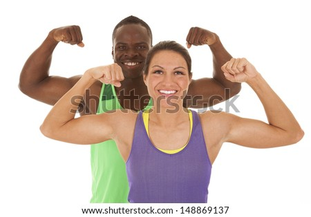 A close up of a man and woman flexing their muscles - stock photo